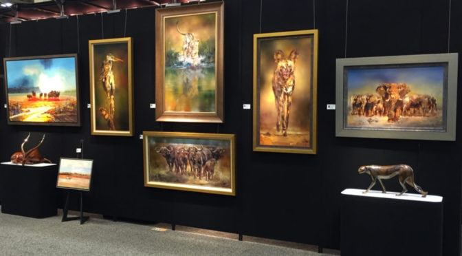 Giclee Prints on Wall at an Art Show